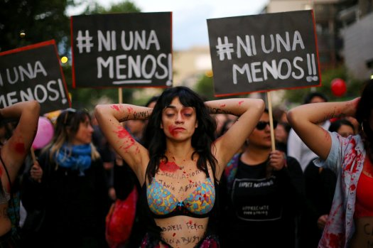 A demonstrator depicting lacerations is seen during a peaceful march against the gender violence in Santiago